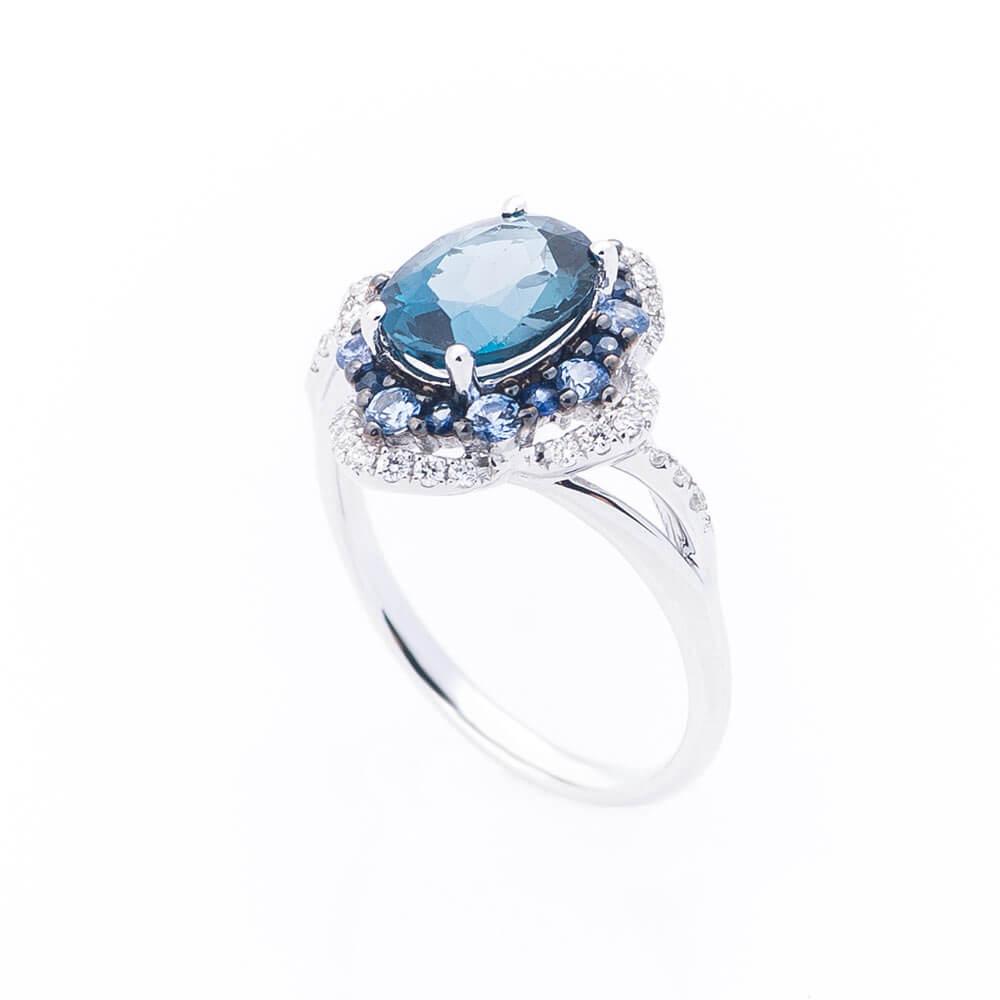 Золотое кольцо с топазом,бриллиантами и сапфирами