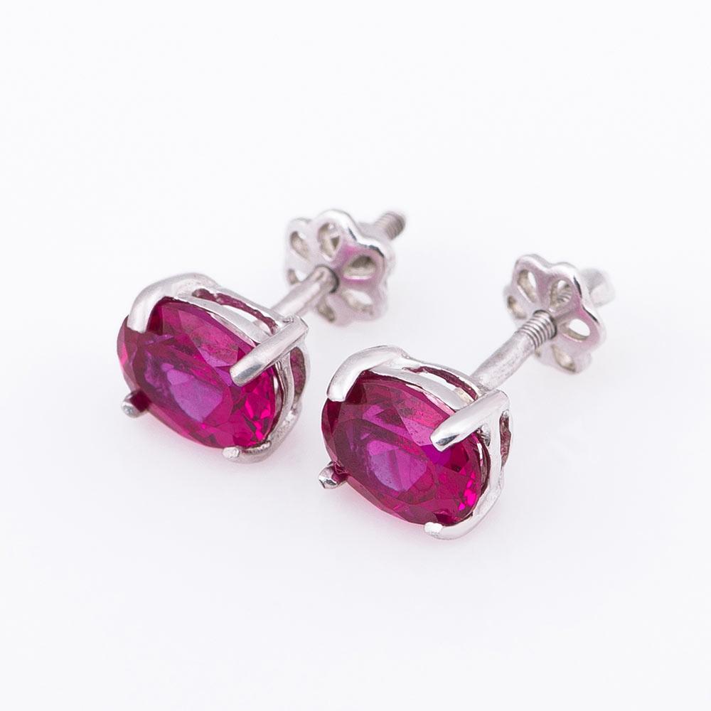 Серебряные серьги-гвоздики с корундом рубином нано 6х8