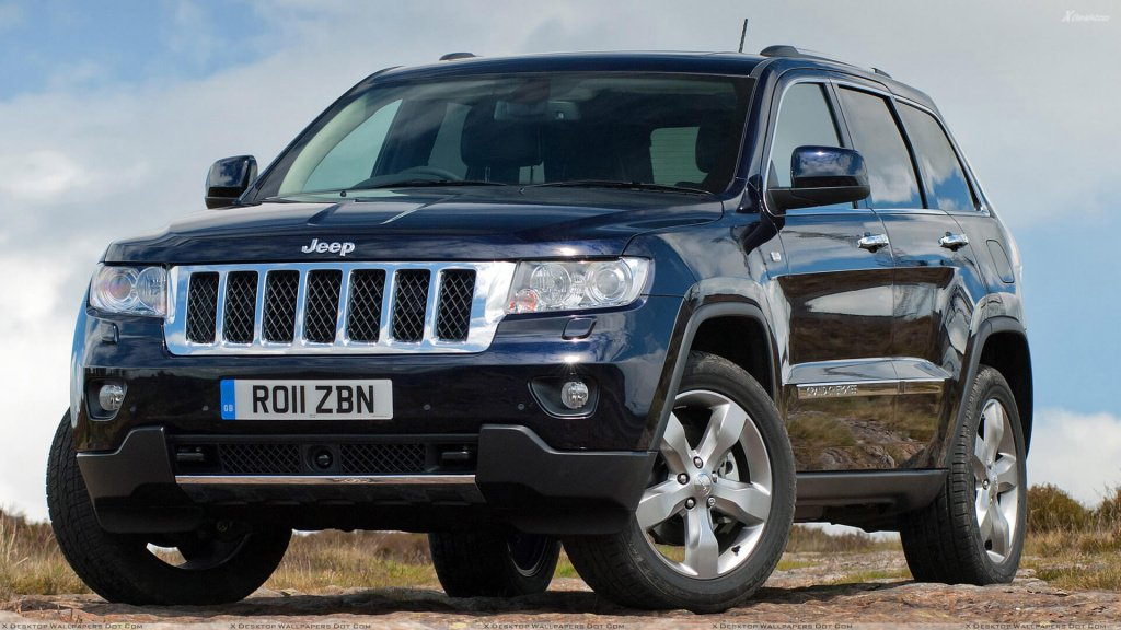 Front Pose Of 2011 Jeep Grand Cherokee In Black.jpg